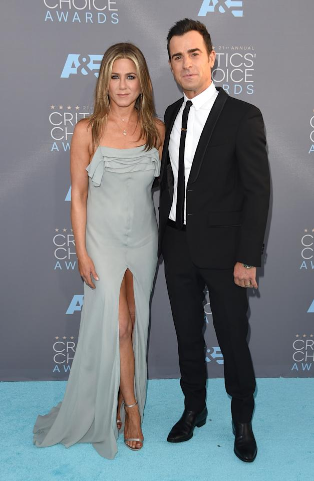 <p>What a dapper pair! While Aniston slipped into a seafoam-hued Saint Laurent by Hedi Slimane number, her hubby went with a Givenchy suit.</p>