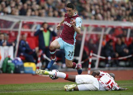 Britain Football Soccer - Stoke City v West Ham United - Premier League - bet365 Stadium - 29/4/17 West Ham United's Jonathan Calleri in action with Stoke City's Bruno Martins Indi Reuters / Andrew Yates Livepic