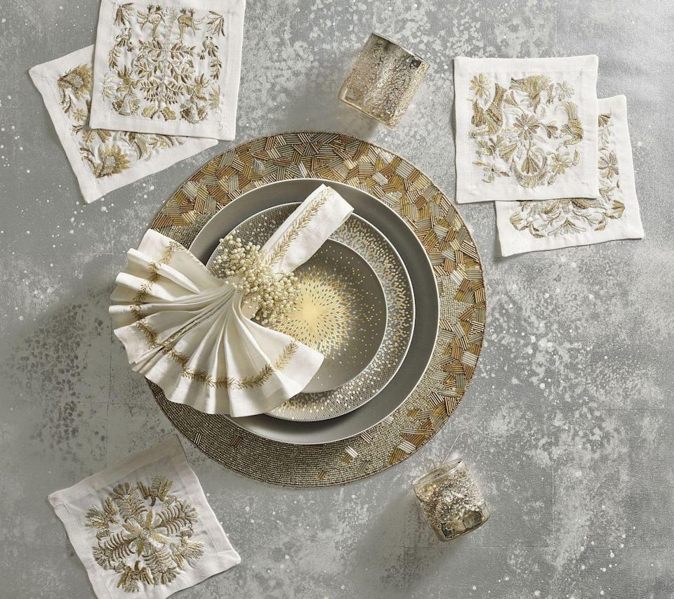 "<p>This beautiful tablescape from tastemaker and tableware designer <a href=""https://kimseybert.com/"" rel=""nofollow noopener"" target=""_blank"" data-ylk=""slk:Kim Seybert"" class=""link rapid-noclick-resp"">Kim Seybert</a> is perfect for a luxe NYE at home. Whether you're used to spending your December 31 at a lavish cocktail party or an idyllic ski chalet on another continent, you can still ring in the New Year in style.</p><p>""Setting a table for New Year's is the perfect time to embrace sparkle and shine,"" Seybert says. ""I love my <a href=""https://kimseybert.com/collections/abstract/"" rel=""nofollow noopener"" target=""_blank"" data-ylk=""slk:Abstract collection"" class=""link rapid-noclick-resp"">Abstract collection</a> and how it adds glow to any table to create a festive atmosphere for family and friends."" </p><p> This tablescape is inspired by twinkling lights for a dreamy vignette, and we especially love these <a href=""https://kimseybert.com/products/otomi-cocktail-napkins-set-of-6-in-gift-box"" rel=""nofollow noopener"" target=""_blank"" data-ylk=""slk:linen cocktail napkins"" class=""link rapid-noclick-resp"">linen cocktail napkins</a> that were inspired by a Mexican tapestry. </p>"