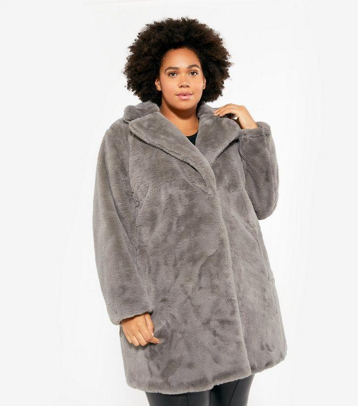 """<br><br><strong>New Look</strong> Curves Dark Grey Faux Fur Long Coat, $, available at <a href=""""https://www.newlook.com/uk/womens/clothing/coats-jackets/curves-dark-grey-faux-fur-long-coat/p/652924303"""" rel=""""nofollow noopener"""" target=""""_blank"""" data-ylk=""""slk:New Look"""" class=""""link rapid-noclick-resp"""">New Look</a>"""