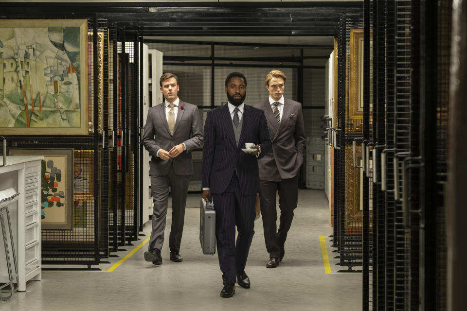 "(L-r) JACK CUTMORE-SCOTT, JOHN DAVID WASHINGTON and ROBERT PATTINSON in Warner Bros. Pictures' action epic ""TENET,"" a Warner Bros. Pictures release.  (Warner Bros.)"