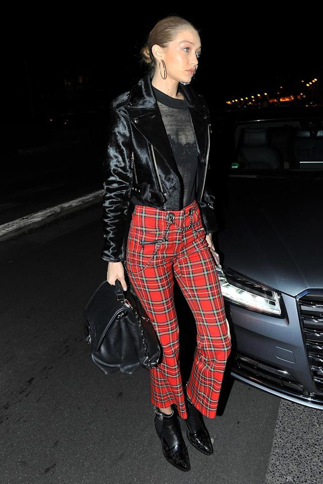 "<p>Supermodel Gigi Hadid wore a sheer top with <a href=""https://miaouxx.com/collections/denim/products/morgan-plaid"" rel=""nofollow noopener"" target=""_blank"" data-ylk=""slk:$325 plaid pants"" class=""link rapid-noclick-resp"">$325 plaid pants</a> from Miaou at a ""V Magazine"" party in March 2017. She completed the look with a fur moto jacket. (Photo: AKM-GSI) </p>"
