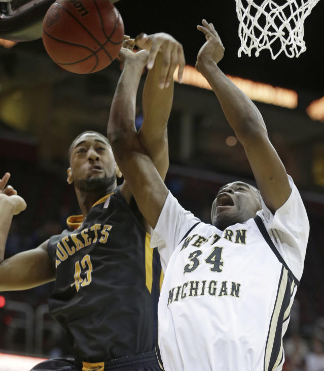 Toledo's Matt Smith (43) knocks the ball loose from Western Michigan's A. J. Avery (34) during the first half of an NCAA college basketball championship game at the Mid-American Conference tournament on Saturday, March 15, 2014, in Cleveland. (AP Photo/Tony Dejak)