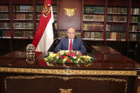 FILE - In this photo provided by Yemen's Presidency Office on Sept. 25, 2014, Yemeni President Abed Rabbo Mansour Hadi delivers a speech in his office at Presidential Palace on the occasion of the 52nd anniversary of North Yemen's the September 26, 1962 revolution in Sanaa, Yemen. (AP Photo/Yemen's Presidency Office)