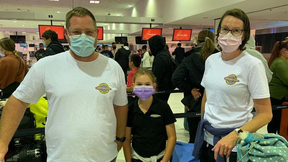 Family wearing masks at Sydney airport
