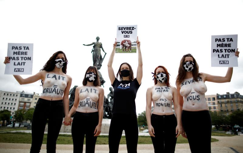 PETA protests against the cruelty of the dairy industry at Place de la Nation square in Paris