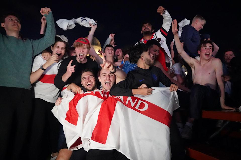 Fans in Trafalgar Square celebrate England qualifying for the Euro 2020 final (PA)
