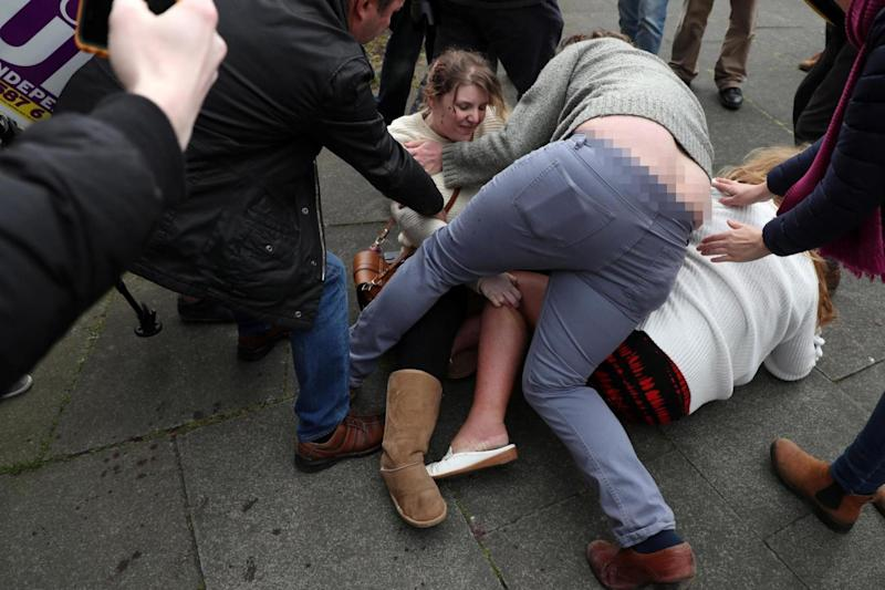 An onlooker wearing a grey jumper tries to break up an argument between two women at a Ukip rally in Hartlepool (Reuters)