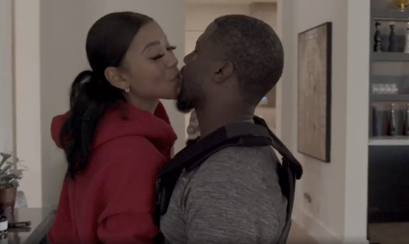 Kevin Hart smooched his wife, Eniko, in the video about his recovery. (Screenshot: Kevin Hart via Instagram)