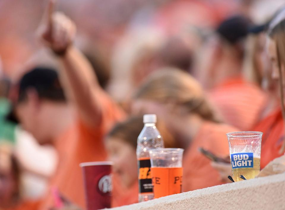 Beverages of Oklahoma state fans line the wall, including beer, which was available at the stadium for the first time, during an NCAA college football game in Stillwater, Okla., Thursday, Aug. 30, 2018. (AP Photo/Brody Schmidt)