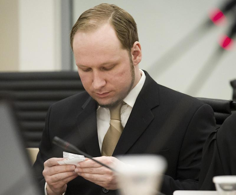 """FILE  This Tuesday May, 29, 2012 file photo shows confessed mass-murderer Anders Behring Breivik looking at this own notes as he sits inside court as the trial against him continues in Oslo, Norway. Breivik, who is serving a 21-year sentence for killing 77 people in a bomb and gun rampage last year, has complained that he is being held in inhumane conditions and is being denied freedom of expression, his lawyer said Friday Nov. 9, 2012. """"He has written a long complaint that he is being held in a section with particularly high security,"""" Tord Jordet told The Associated Press. """"He is today the only one in this ward and the security regime is the strictest in Norway.""""  (AP Photo / Heiko Junge, NTB scanpix, file) NORWAY OUT"""