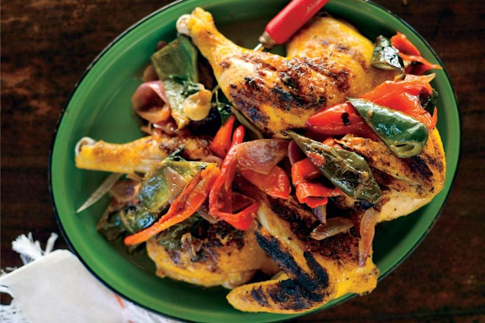"""Like a drizzle of olive oil, a dose of avocado adds richness and flavor to <a href=""""https://www.epicurious.com/expert-advice/best-grilled-chicken-recipes-for-summer-and-fall-gallery?mbid=synd_yahoo_rss"""" rel=""""nofollow noopener"""" target=""""_blank"""" data-ylk=""""slk:grilled chicken"""" class=""""link rapid-noclick-resp"""">grilled chicken</a>. Cooking the chicken under a brick results in the crispiest skin imaginable. <a href=""""https://www.epicurious.com/recipes/food/views/chicken-under-a-brick-with-avocados-and-chiles-51104670?mbid=synd_yahoo_rss"""" rel=""""nofollow noopener"""" target=""""_blank"""" data-ylk=""""slk:See recipe."""" class=""""link rapid-noclick-resp"""">See recipe.</a>"""