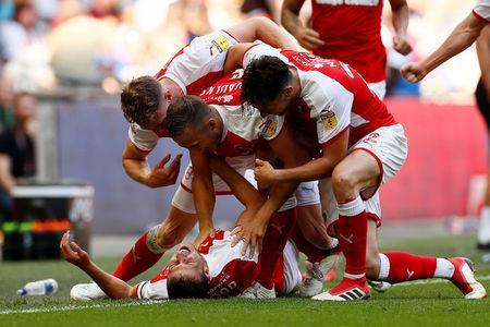 Soccer Football - League One Play-Off Final - Rotherham United v Shrewsbury Town - Wembley Stadium, London, Britain - May 27, 2018 Rotherham's Richard Wood celebrates scoring their second goal with team mates Action Images/Jason Cairnduff