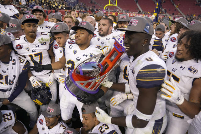 California players celebrate with the trophy after a win over Illinois during the Redbox Bowl NCAA college football game Monday, Dec. 30, 2019, in Santa Clara, Calif. (AP Photo/Tony Avelar)