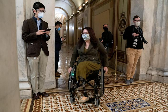 Sen. Tammy Duckworth wears a protective mask at the U.S. Capitol on Feb. 13, 2021. She was wounded in Iraq in 2004 while piloting a Black Hawk helicopter as a member of the Illinois National Guard.