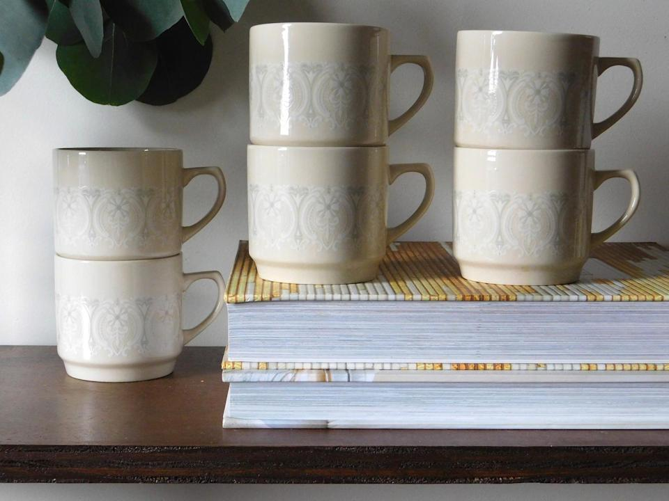 <p>They'll enjoy their morning drink in style with these <span>The Collected Goods Vintage Mugs</span> ($32 for six).</p>
