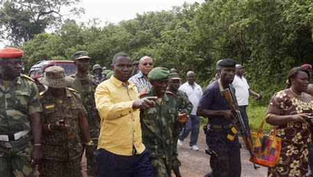 The Governor of Goma, Julien Paluku Kahongya (4th L), arrives in the company of senior military officers from the Congolese armed forces battling M23 rebels in Kibumba, north of Goma, October 26, 2013. REUTERS/Kenny Katombe
