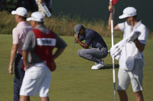 Tiger Woods' return to U.S. Open competition started with a triple bogey, the highest single-hole score of the day. (AP)