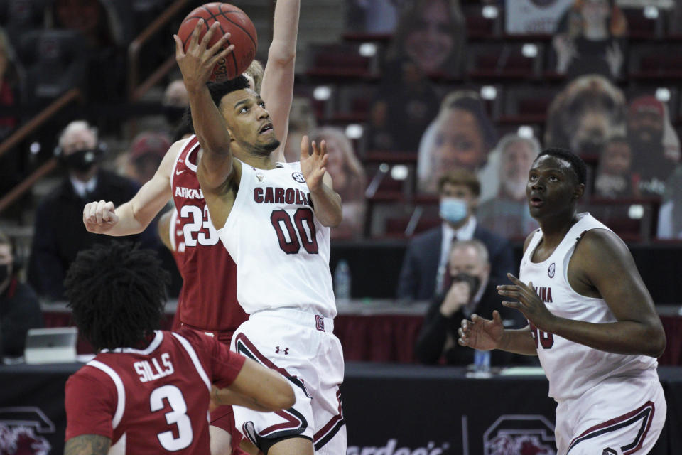 South Carolina guard AJ Lawson (00) drives to the basket during the first half of the team's NCAA college basketball game against Arkansas on Tuesday, March 2, 2021, in Columbia, S.C. (AP Photo/Sean Rayford)