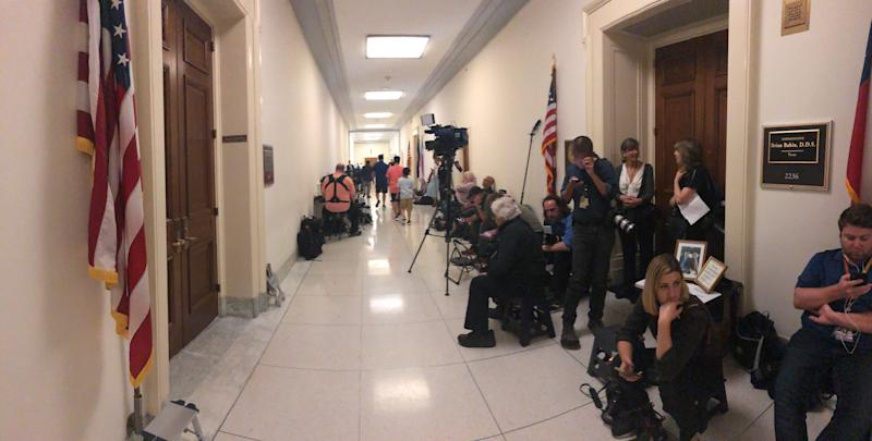 Journalists crowd outside of Rep. Brian Babin's office waiting for lawmakers on the House Judiciary Committee, which was meeting with former White House aide Hope Hicks on Wednesday.