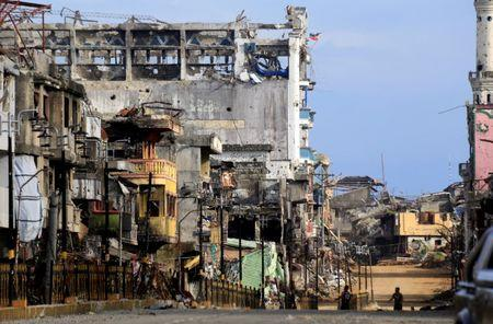 Damaged buildings are seen after government troops cleared the area from pro-Islamic State militant groups inside war-torn Bangolo town, Marawi City, southern Philippines October 23, 2017. REUTERS/Romeo Ranoco