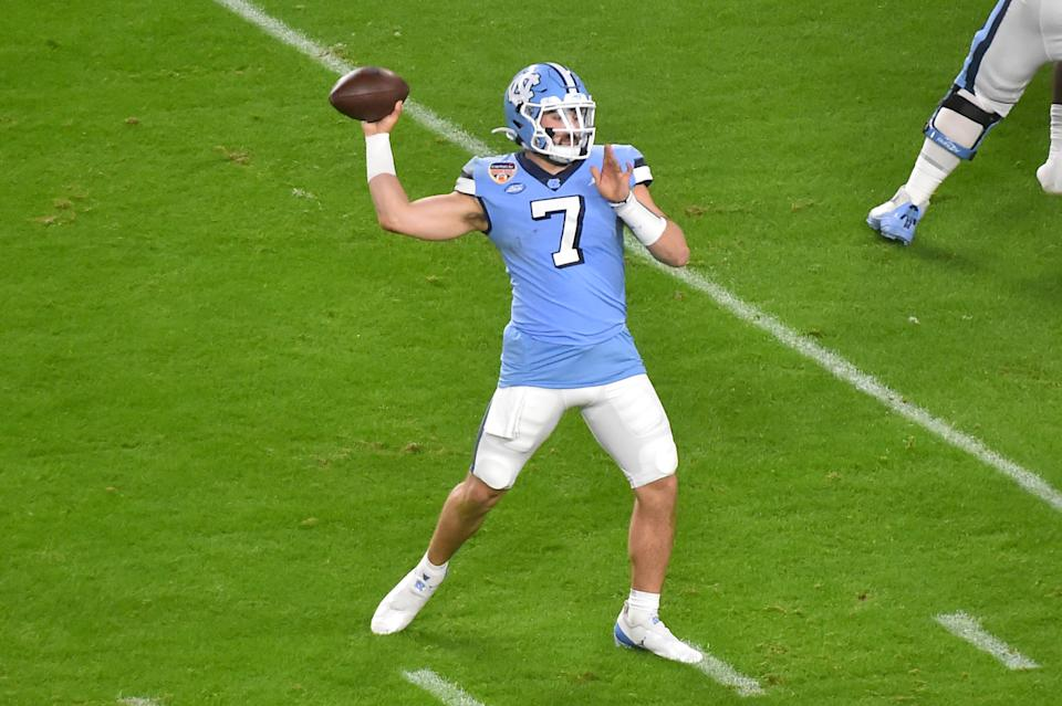 MIAMI GARDENS, FL - JANUARY 02: Sam Howell #7 of the North Carolina Tar Heels drops back to pass during the first quarter of the Capital One Orange Bowl against the Texas A&M Aggies at Hard Rock Stadium on January 2, 2021 in Miami Gardens, Florida. (Photo by Eric Espada/Getty Images)