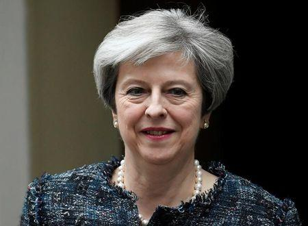 Britain's Prime Minister Theresa May leaves 10 Downing Street to travel to Buckingham Palace to visit Queen Elizabeth after Parliament was dissolved prior to the general election, in London