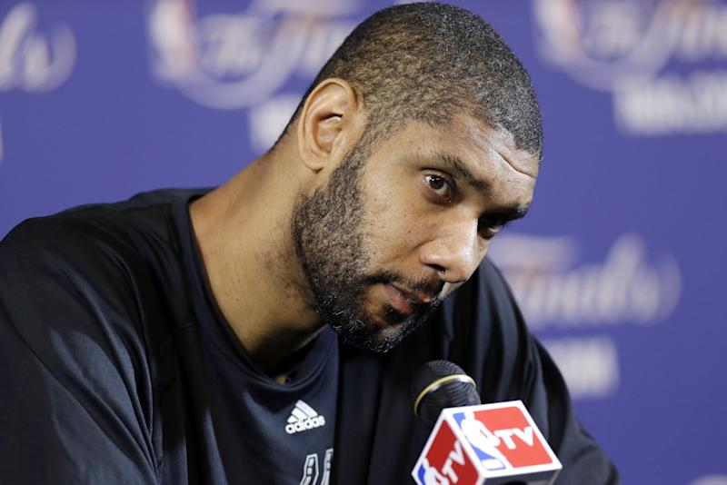 San Antonio Spurs' Tim Duncan listens to a question during a news conference at NBA basketball practice, Wednesday, June 5, 2013 in Miami. The Spurs play the Miami Heat in Game 1 of the NBA Finals on Thursday. (AP Photo/Lynne Sladky)