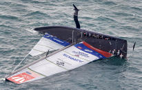 United States' American Magic capsizes during it's race against Italy's Luna Rossa on the third day of racing of the America's Cup challenger series on Auckland's Waitemate Harbour, New Zealand, Sunday, Jan. 17, 2021. (COR 36 Studio Borlenghi via AP)