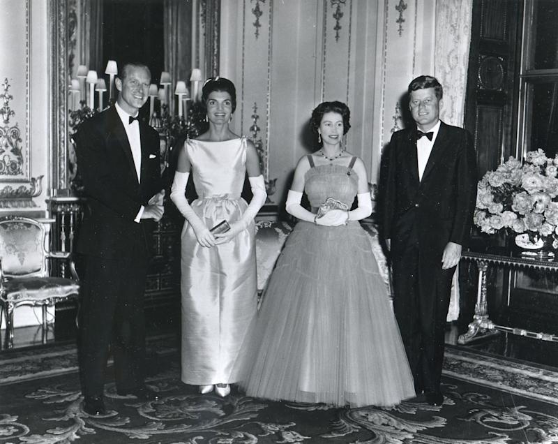 At Buckingham Palace during a banquet held in his honor, American President John F. Kennedy and his wife, First Lady Jacqueline Kennedy, pose with Queen Elizabeth II of Great Britain and her husband, Prince Philip, Duke of Edinburgh, London, United Kingdom, June 15, 1961.