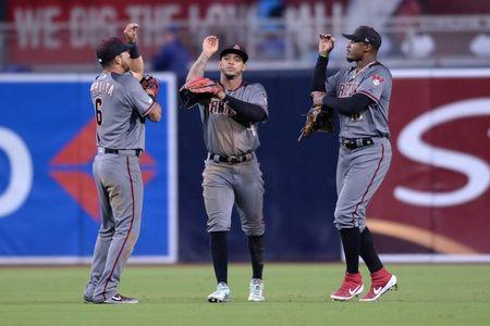 Apr 1, 2019; San Diego, CA, USA; Arizona Diamondbacks outfielders David Peralta and Ketel Marte and Adam Jones, (from left) celebrate after defeating the San Diego Padres at Petco Park. Mandatory Credit: Orlando Ramirez-USA TODAY Sports