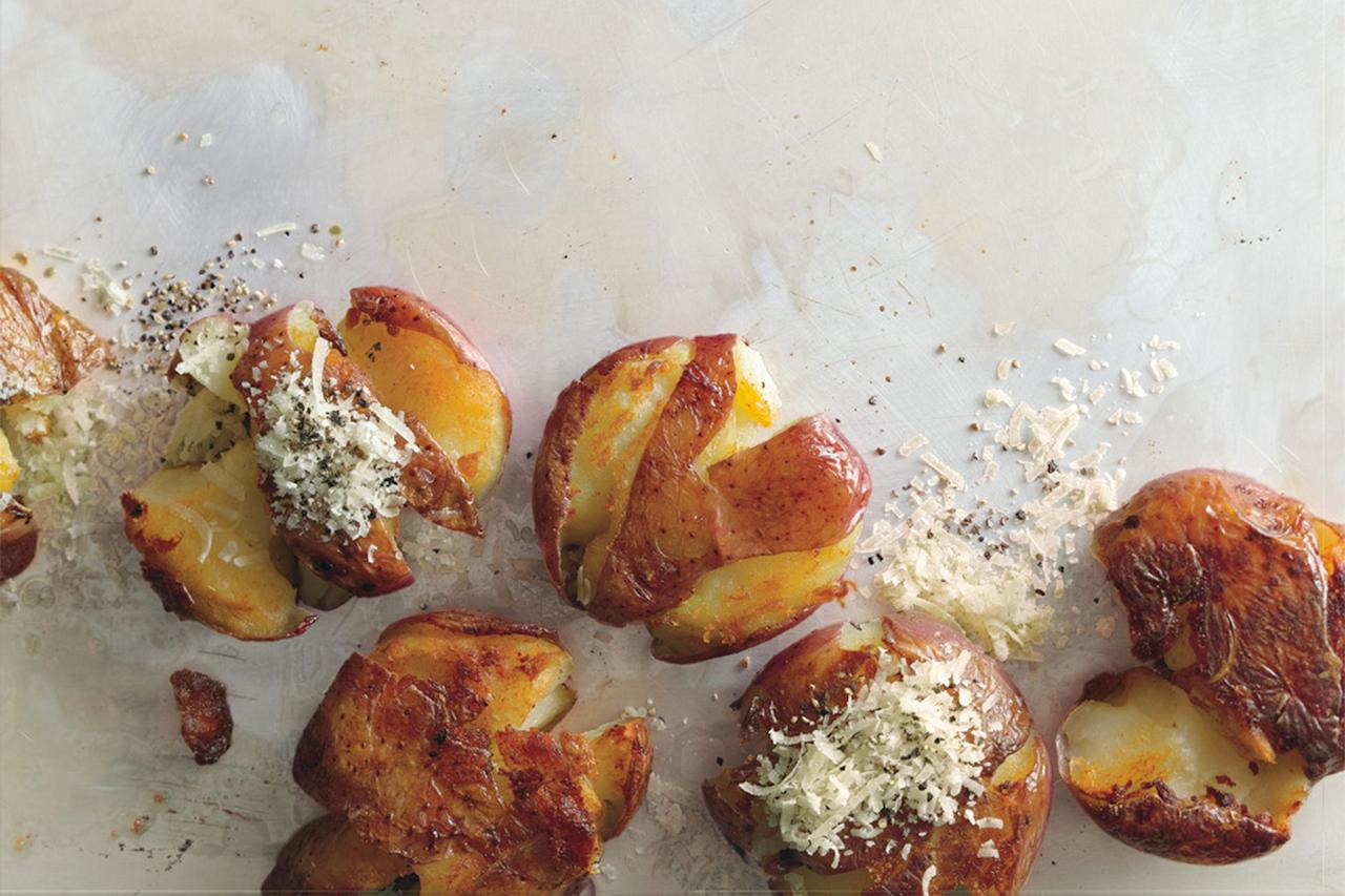 """Salty Parmesan seasons these crispy mashed potatoes. We love how tender and creamy they are on the inside. (And that there's no peeling required.) <a href=""""https://www.epicurious.com/recipes/food/views/panfried-smashed-potatoes-351809?mbid=synd_yahoo_rss"""">See recipe.</a>"""