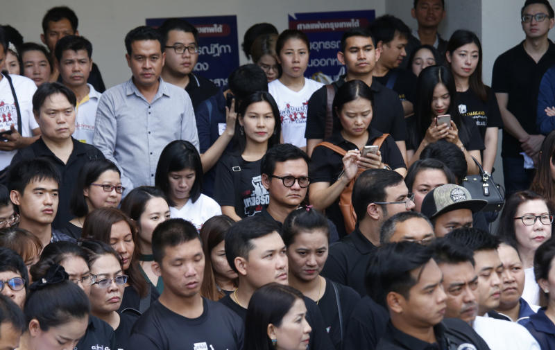 Plaintiffs of Ford cars with bad transmissions gather outside civil court after a verdict in a class-action lawsuit in Bangkok, Thailand, Friday, Sept. 21, 2018. The Thai court has ordered Ford Motor Co. to pay 291 customers a total of around $720,000 in compensation for selling cars equipped with faulty transmissions. (AP Photo/Sakchai Lalit)