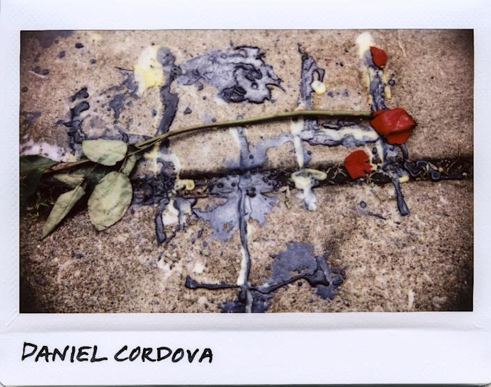 A rose and melted wax from candles used at a vigil for Daniel Cordova, 26, found dead of multiple gunshot wounds in Chicago in May 2017 (AFP Photo/JIM YOUNG)