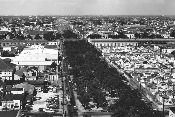 """This photo provided by the City Archives & Special Collections, New Orleans Public Library shows an aerial view of Claiborne Avenue lined with oak trees in the heart of New Orleans in August 1968. Soon after this photo was taken, an expressway was constructed on top of Claiborne Avenue — ripping up the oak trees and tearing apart a street sometimes called the """"Main Street of Black New Orleans."""". (City Archives & Special Collections, New Orleans Public Library via AP)"""