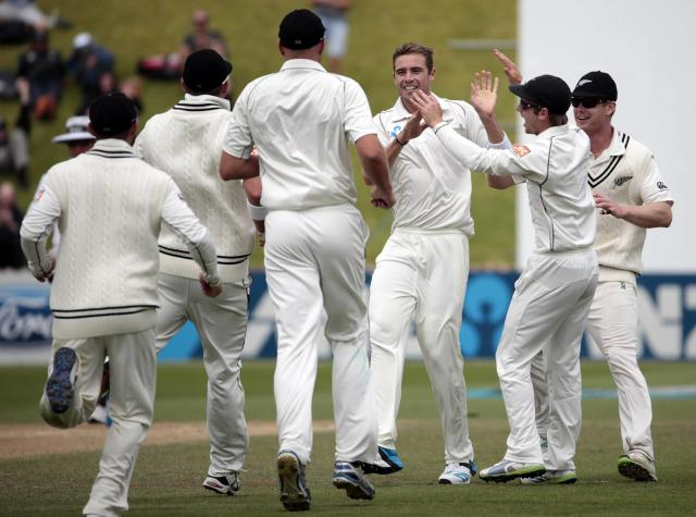 New Zealand's Tim Southee (3rd R) celebrates the dismissal of India's Murali Vijay during the second innings of play on day five of the second international test cricket match at the Basin Reserve in Wellington, February 18, 2014. REUTERS/Anthony Phelps (NEW ZEALAND - Tags: SPORT CRICKET)
