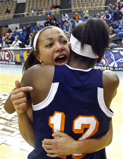 Tennessee Martin guard Heather Butler, left, celebrates with guard Jasmine Newsome (12) after the championship game against Tennessee Tech in the Ohio Valley Conference NCAA college basketball tournament on Saturday, March 9, 2013, in Nashville, Tenn. Tennessee Martin won 87-80 in overtime for their third consecutive championship. (AP Photo/Wade Payne)