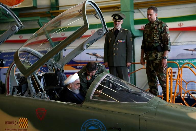 "President Hassan Rouhani sits in the cockpit of Iran's new ""Kowsar"" domestic fighter jet"