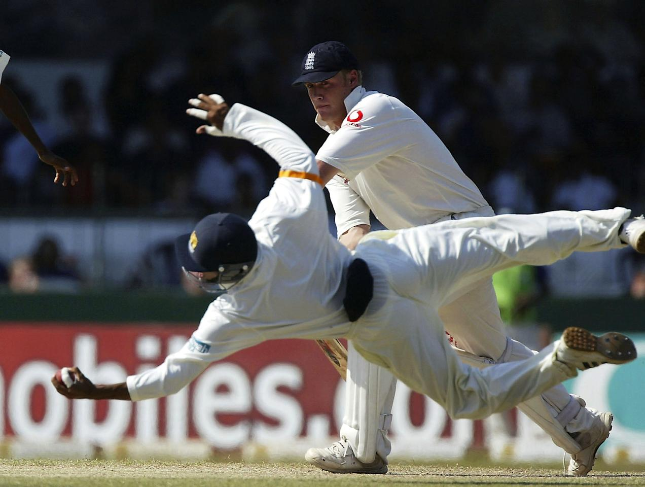 COLOMBO, SRI LANKA - DECEMBER 21:  Tillakaratne Dilshan of Sri Lanka makes a flying catch off Andrew Flintoff of England during the fourth day of the Third Test between Sri Lanka and England the Singhalese Sports Club, on December 21 2003, in Colombo, Sri Lanka. (Photo by Tom Shaw/Getty Images)