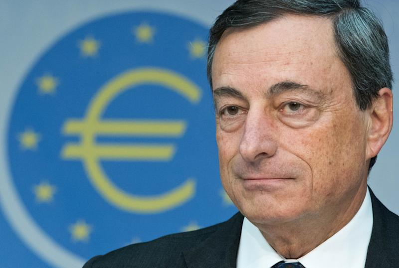 President of European Central Bank, ECB, Mario Draghi speaks during a news conference in Frankfurt, Germany, Thursday, Aug. 1, 2013. Draghi held the door open for another interest rate cut if the struggling euro area economy needs more stimulus. Draghi spoke Thursday, Aug. 1, 2013, after the ECB left its benchmark interest rate unchanged at 0.5 percent. (AP Photo/Boris Roessler/picture-alliance/dpa/AP Images