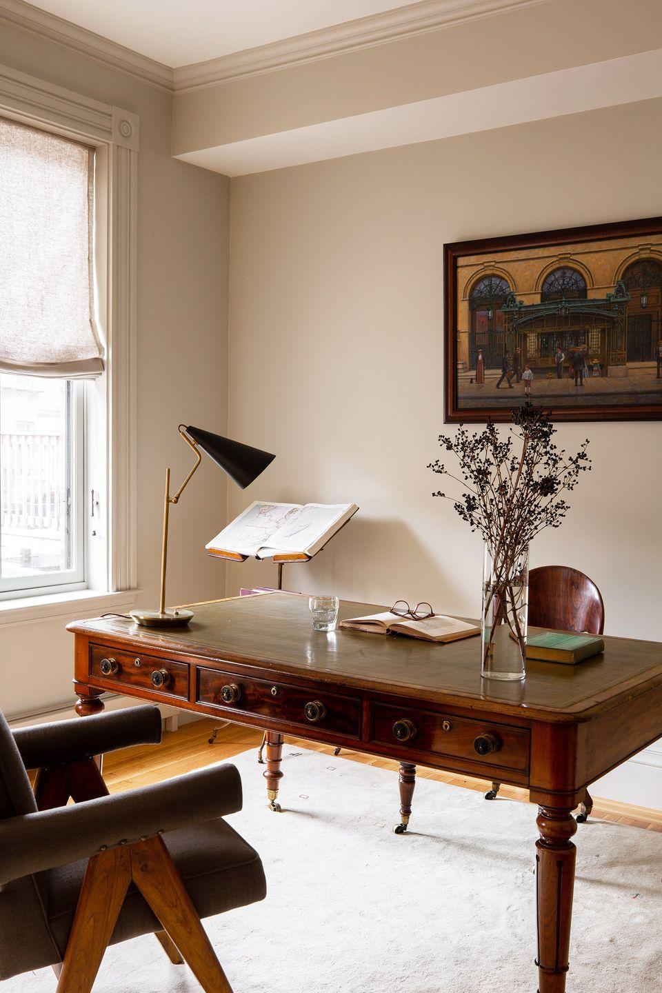 """<p>Modern lighting and seating blend beautifully with antiques in this home office designed by <a href=""""https://www.jaejoodesigns.com/"""" rel=""""nofollow noopener"""" target=""""_blank"""" data-ylk=""""slk:Jae Joo"""" class=""""link rapid-noclick-resp"""">Jae Joo</a>. Tasked with redecorating this Boston rowhouse, she made sure to honor its historical integrity while also bringing it into the 21st century. Cream walls also prove that white isn't always the best route. </p>"""