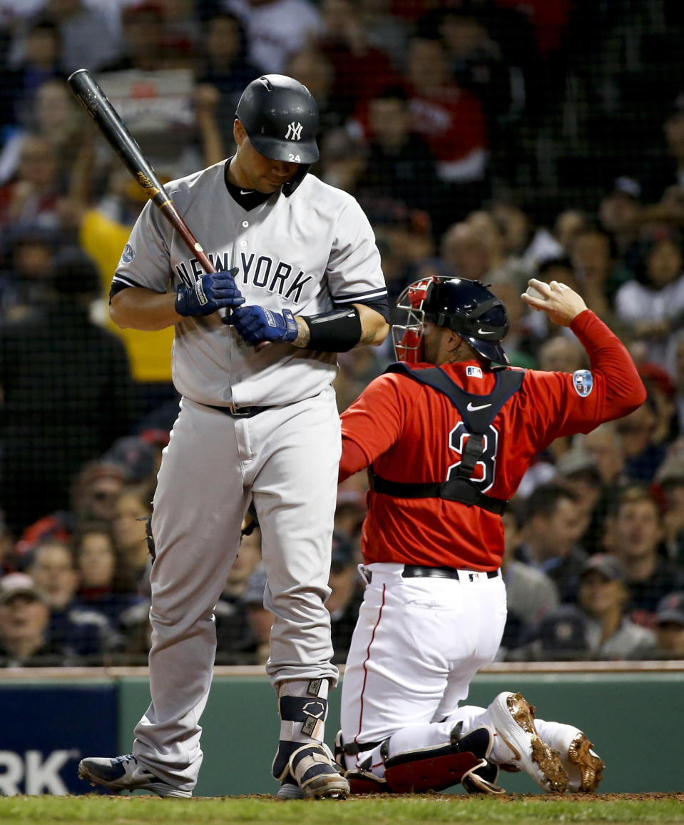 New York Yankees' Gary Sanchez reacts after striking out against the Boston Red Sox during the third inning of Game 1 of a baseball American League Division Series on Friday, Oct. 5, 2018, in Boston. (AP Photo/Elise Amendola)