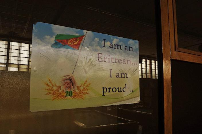 A patriotic poster displayed on a window of a billiard room in Asmara, Eritrea on July 20, 2013 (AFP Photo/Jenny Vaughan)