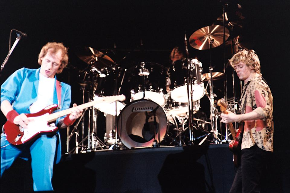 Mark Knopfler, John Illsley, Straits, Brothers in Arms Tour, 12 July 1985 Wembley Arena. (Photo by Solomon N'Jie/Getty Images)