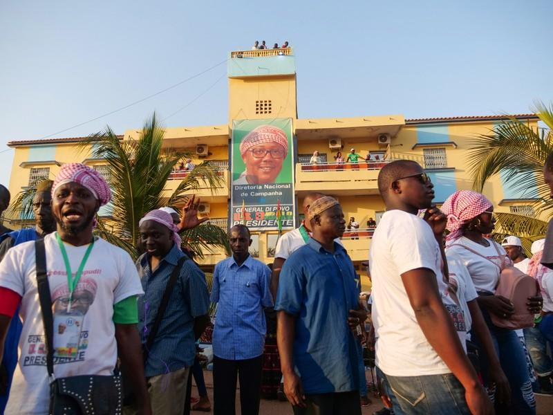 Supporters of presidential candidate Umaro Sissoko Embalo gather outside his campaign headquarters in Bissau