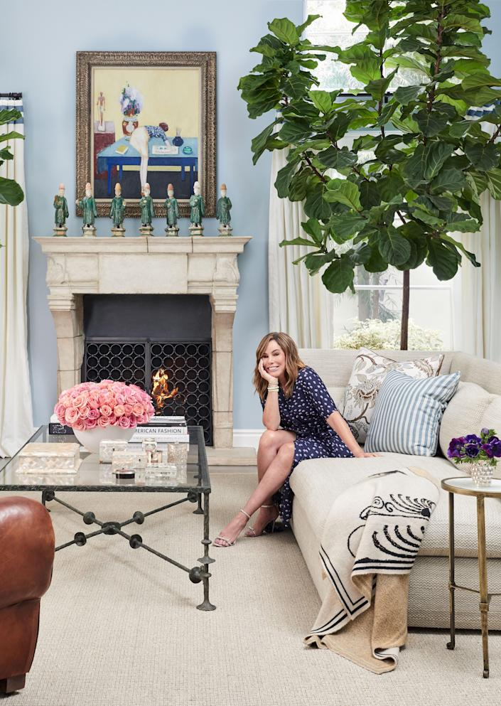 """""""I am a plant killer,"""" Rivers, pictured in her home's living room, says. """"But luckily, my gardener comes in and makes sure I haven't murdered them over the course of a few weeks. It's not on purpose—I'm a great pet owner, not a plant owner."""""""