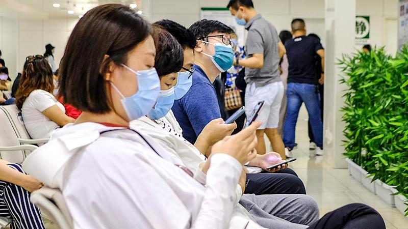 A group of people wait to see the doctor in the hospital with protective masks on June 8, 2020 in Beijing, China.