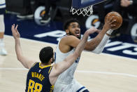 Minnesota Timberwolves' Karl-Anthony Towns (32) is fouled by Indiana Pacers' Goga Bitadze (88) as he goes up for a shot during the first half of an NBA basketball game, Wednesday, April 7, 2021, in Indianapolis. (AP Photo/Darron Cummings)