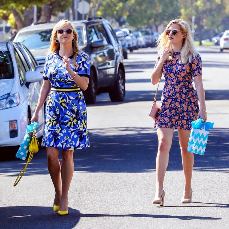 Witherspoon and daughter Ava in matching floral dresses