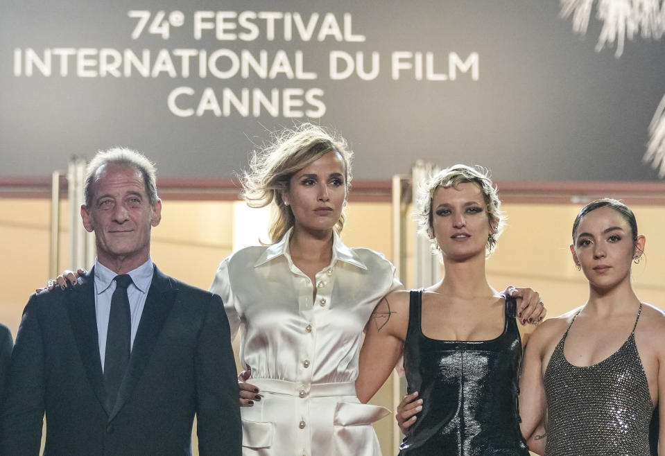 Vincent Lindon, from left, director Julia Ducournau, Agathe Rousselle, Garance Marillier and Lais Salameh pose for photographers upon arrival at the premiere of the film 'Titane' at the 74th international film festival, Cannes, southern France, Tuesday, July 13, 2021. (AP Photo/Vadim Ghirda)